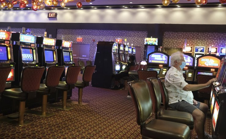Gamblers playing the slot machines were limited to every other machine to encourage social distancing at the Golden Nugget Casino in Atlantic City, N.J., Thursday, July 2, 2020. AP