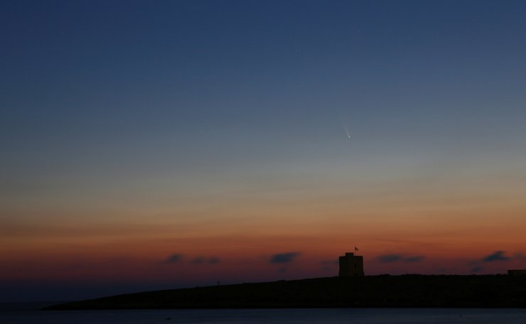 The Comet C/2020 or 'Neowise' is seen in the sky behind St Mark's Tower, a 17th century coastal fortification near the village of Bahar ic-Caghaq, Malta July 12, 2020. Reuters
