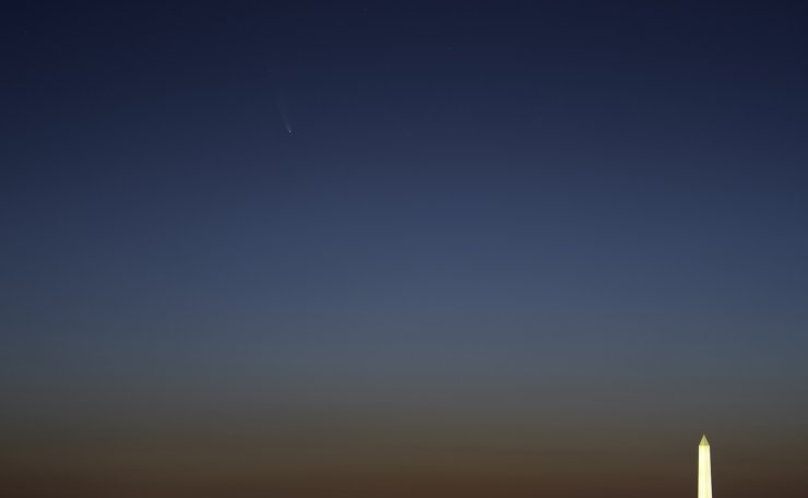 Comet NEOWISE, upper left, is seen before sunrise over Washington, Sunday, July 12, 2020. AP
