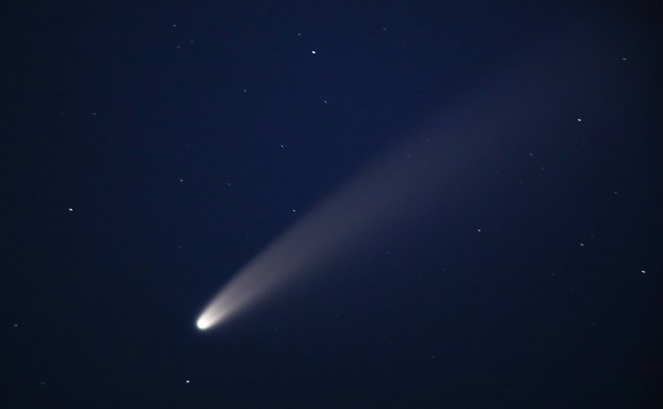 Comet NEOWISE is seen in the night sky. The retrograde comet C/2020 F3 (NEOWISE) was discovered on March 27, 2020, using the NEOWISE infrared space telescope. TASS