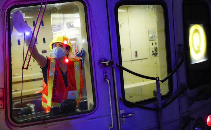 A contractor cleans a subway car at the 96th Street station to control the spread of COVID-19, Thursday, July 2, 2020, in New York. Mass transit systems around the world have taken unprecedented — and expensive — steps to curb the spread of the coronavirus, including shutting down New York subways overnight and testing powerful ultraviolet lamps to disinfect seats, poles and floors. AP