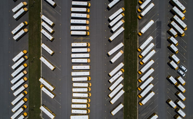 An image made with a drone shows school buses parked at the Loudoun County Public School Transportation Center in Leesburg, Virginia, USA, 13 July 2020. US President Donald J. Trump and Education Secretary Betsy DeVos are calling for public schools to fully reopen later this summer, despite the ongoing COVID-19 pandemic. EPA