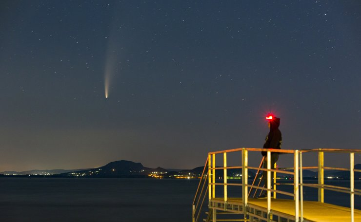 The Comet NEOWISE or C/2020 F3 is seen before sunrise over Balatonmariafurdo, Hungary, 14 July 2020. The comet passed closest to the Sun on 03 July and its closest approach to Earth will occur on 23 July. EPA