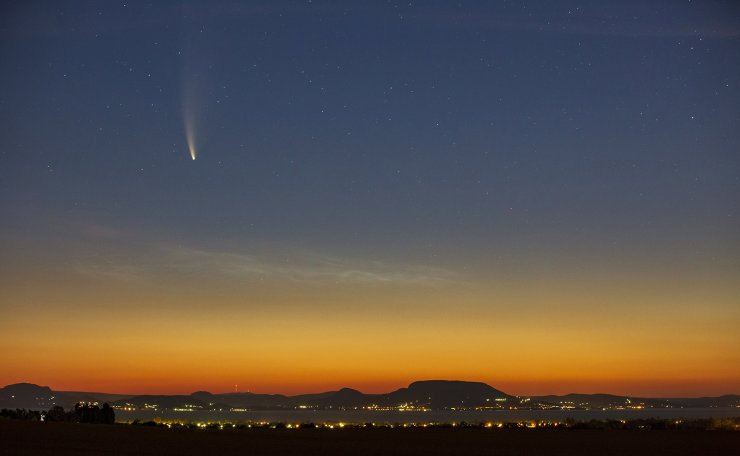 The Comet NEOWISE or C/2020 F3 is seen at dawn over Balatonmariafurdo, Hungary, 14 July 2020. The comet passed closest to the Sun on 03 July and its closest approach to Earth will occur on 23 July. EPA