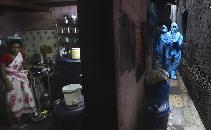 Health workers screen people for COVID-19 symptoms at a slum in Mumbai, India, Tuesday, July 14, 2020. Several Indian states imposed weekend curfews and locked down high-risk areas as the number of coronavirus cases surged past 900,000 on Tuesday. AP