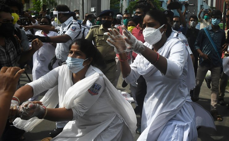 State police officials arrest Left-wing students as they demonstrate against the government for failing to control the spread of the of the COVID-19 coronavirus, in Kolkata on July 14, 2020. AFP