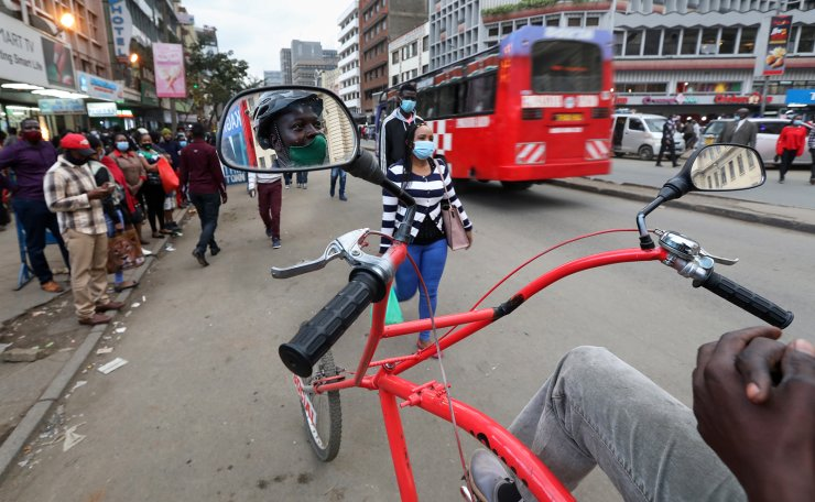 Kenyan man Isaac Tarit, 38, poses on his custom-made bicycle that he uses to sensitize people on the coronavirus and how to prevent Covid-19 infections in the streets of Nairobi, Kenya, 14 July 2020. Kenya youths have recently been coming up with different creative forms of arts to create awareness on Covid-19 as a way to curb the spread of the virus as the country continues to battle to control community transmissions. EPA