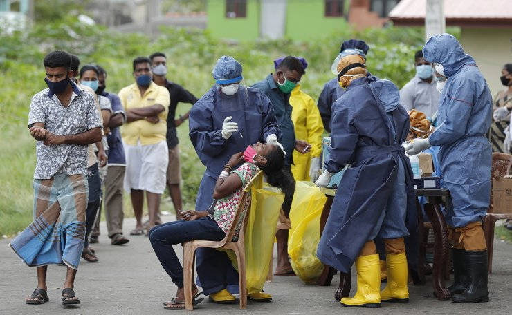 Sri Lankans wait for their turn to give their nasal swab samples to test for COVID-19 in Colombo, Sri Lanka, Wednesday, July 15, 2020. AP