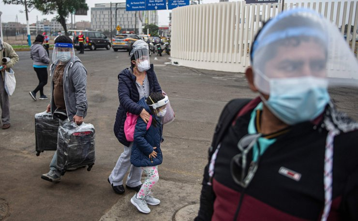 Passengers arrive at Jorge Chavez International Airport in Lima on July 15, 2020 as airports across Peru reopened for domestic flights as part of the easing of measures against the COVID-19 novel coronavirus pandemic. AFP
