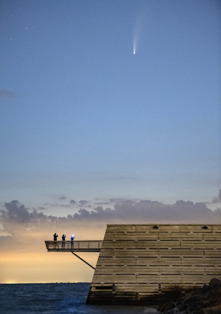 The comet Neowise is seen in the night sky in Vastra Hamnen, in Malmo, Sweden, Friday, July 17, 2020. AP