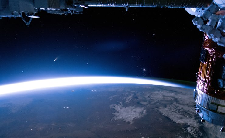 A handout picture made available by the National Aeronautics and Space Administration (NASA) shows Comet NEOWISE (short for C/2020 F3 NEOWISE) viewed from the International Space Station (ISS) on 05 July 2020 (issued 18 July 2020). EPA
