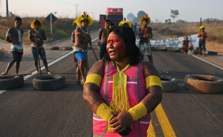 Members of the Kayapo tribe block the middle of highway BR163 with a barricade during a protest on the outskirts of Novo Progresso in Para State, Brazil, on August 17, 2020 amid the COVID-19 novel coronavirus pandemic. - Indigenous protestors blocked a major Trans-Amazonian highway to protest against the lack of governmental support during the COVID-19 pandemic and illegal deforestation in and around their territories. AFP