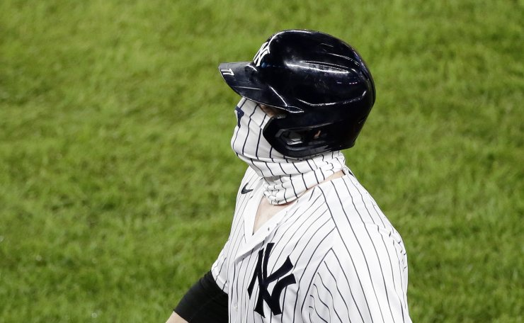 New York Yankees Clint Frazier wears a face mask as he walks back to the dug out after grounding out in the fifth inning against the Boston Red Sox at Yankee Stadium on Monday, August 17, 2020 in New York City. UPI