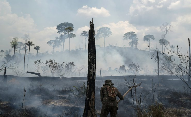 Brazilian soldier puts out fires at the Nova Fronteira region in Novo Progresso, Brazil. In 2019, the forest around the town of Novo Progresso erupted into flames — the first major blazes in the Brazilian Amazon's dry season and spurred global outrage against the government's inability or unwillingness to protect the rainforest. AP