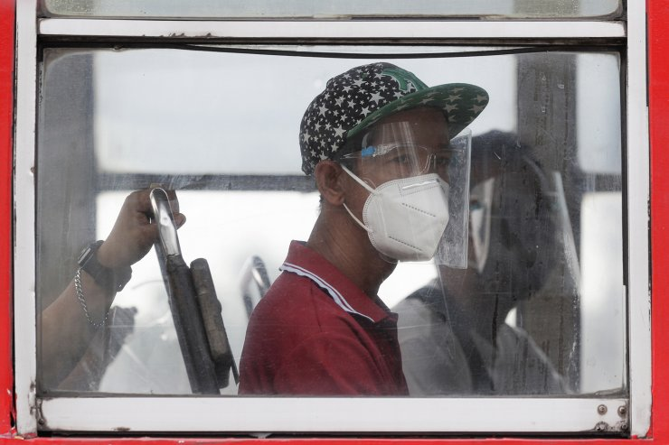 People wearing face mask and face shields to help curb the spread of COVID-19 ride a bus in Quezon city, Philippines on Wednesday, Aug. 19, 2020. Philippine President Rodrigo Duterte has decided to ease a mild coronavirus lockdown in the capital and four outlying provinces to further reopen the country's battered economy despite having the most reported infections in Southeast Asia. AP