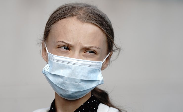 Climate activists Greta Thunberg wears a face mask as she arrives for a meeting with German Chancellor Angela Merkel at the chancellery in Berlin, Germany, Thursday, Aug. 20, 2020. AP