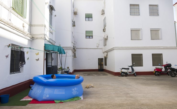 Conchi Moreno and Juan Carlos Morales bathe in a portable plastic pool in the community association patio in Seville on Aug. 14, 2020. The pool sits next to the entrance of their flat and they decided to buy it because 'we are scared to go to the public pool or the beach due to the Covid'. As pretty much everywhere else, the coronavirus pandemic has meant more time at home for Spaniards. AP