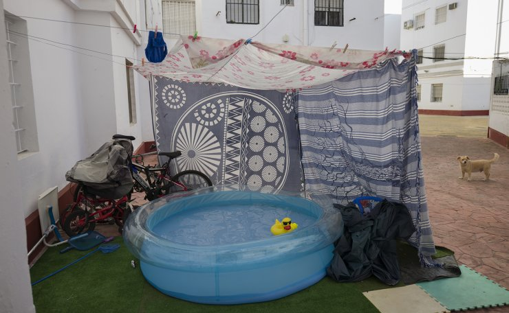 A rubber duck floats in a portable plastic pool that sits in the community housing association patio in Seville, Spain on Aug. 14, 2020. AP