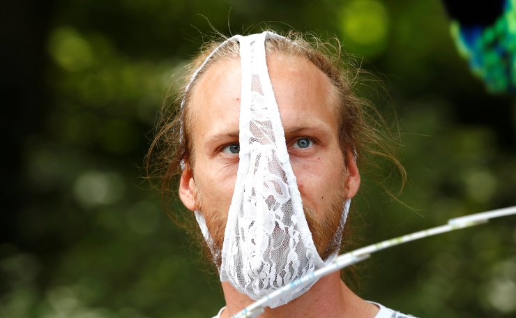 A demonstrator wearing underwear to cover his face attends a rally against the government's restrictions following the coronavirus disease (COVID-19) outbreak, in Berlin, Germany August 29, 2020. Reuters