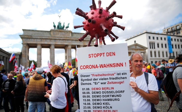 A demonstrator holds a placard during a rally against the government's restrictions following the coronavirus disease (COVID-19) outbreak, in Berlin, Germany August 29, 2020. Reuters