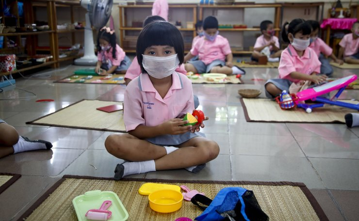 Children wearing face masks as a preventative measure against the SARS-CoV-2 coronavirus play with toys at a kindergarten in Bangkok. Thailand officially marked 100 days since it last reported domestic COVID-19 infection on 02 September 2020, remaining one of the world's few success stories in terms of curbing the spread of SAR-CoV-2. EPA