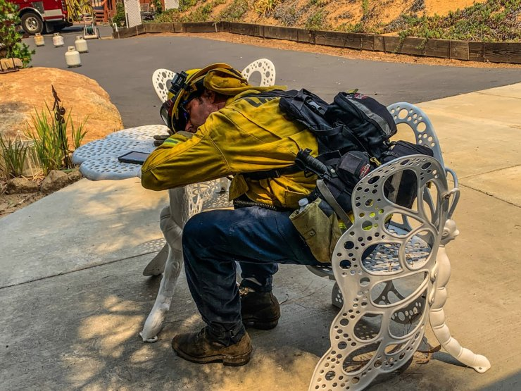 A firefighter takes a rest during works to extinguish a fire in Alpine, California, U.S., September 6, 2020, in this picture obtained from social media. Reuters