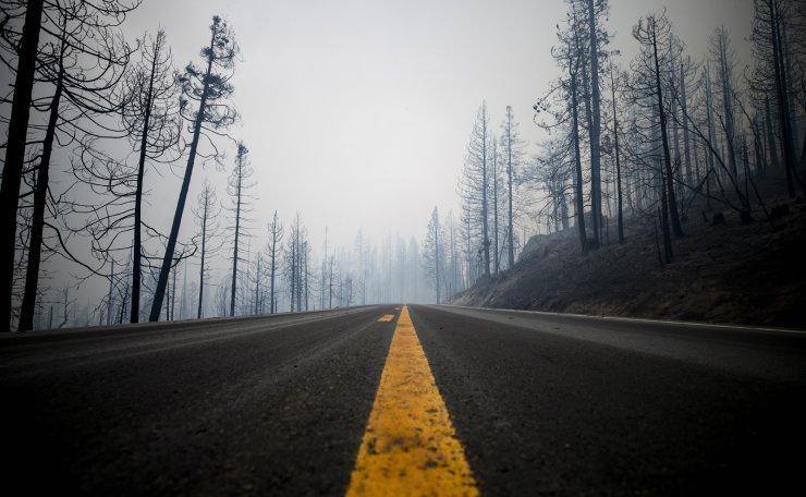 Smoke from the Creek Fire engulfs the scorched trees surrounding the 168 near Shaver Lake in the Sierra National Forest, California, USA, 07 September 2020. EPA