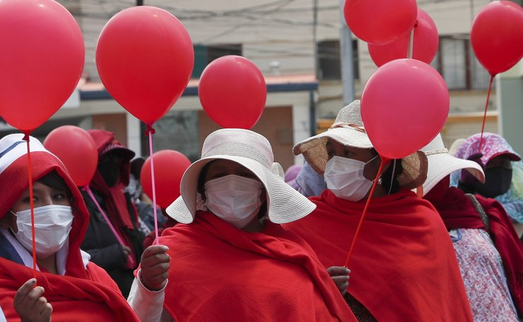 Wearing masks amid the new coronavirus pandemic, sex workers protest asking the government to lift restrictions on their work, in La Paz, Bolivia, Tuesday, Sept. 8, 2020. AP