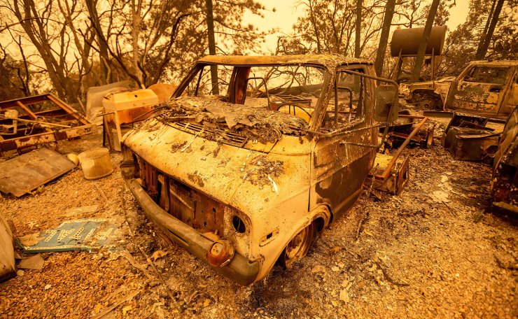 A burned van smolders during the Creek fire in an unincorporated area of Fresno County, California on September 08, 2020. AFP