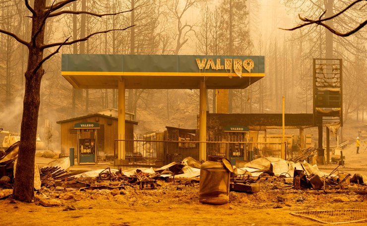 A burned Valero gas station smolders during the Creek fire in an unincorporated area of Fresno County, California on September 08, 2020. AFP