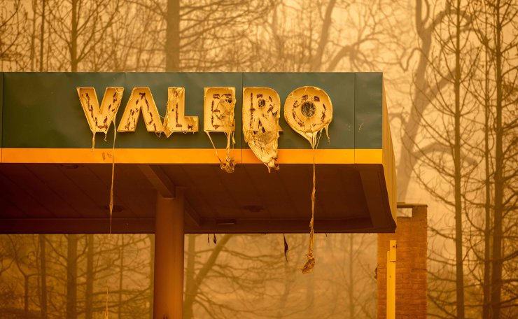 A burned Valero gas station smolders during the Creek fire in an unincorporated area of Fresno County, California on September 08, 2020. - Wildfires in California have torched a record more than two million acres, the state fire department said on September 7, as smoke hampered efforts to airlift dozens of people trapped by an uncontrolled blaze. AFP
