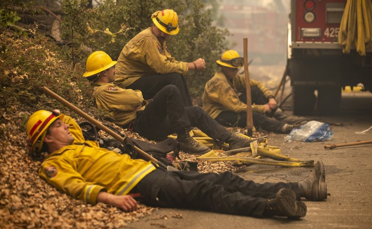 Firefighters Rob Spitzer, Max Katay, Josiah Gist and Hunter Grossmann of the Rancheria Station rest in the smoldering forest in the Cascadel Woods after battling the Creek Fire all night near North Fork in the Sierra National Forest, California, USA, 08 September 2020. EPA
