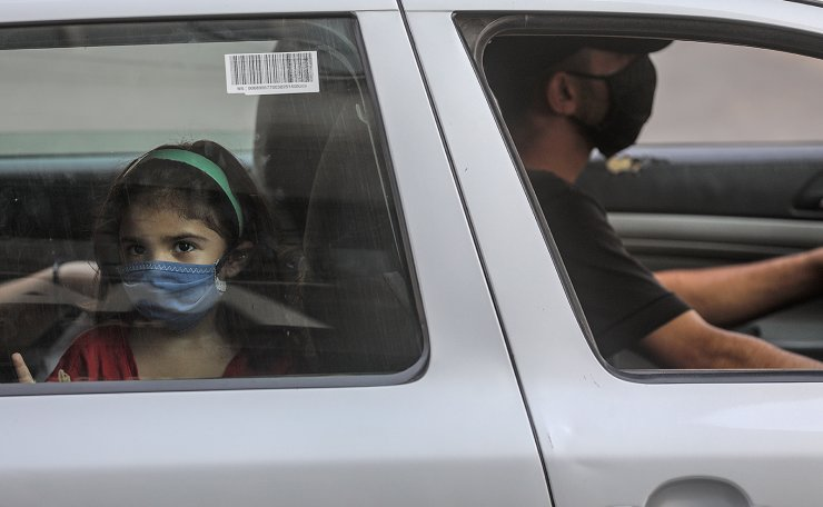 alestinians wearing protective face masks amid the ongoing coronavirus COVID-19 pandemic in Gaza port, Gaza City, 10 September 2020. EPA
