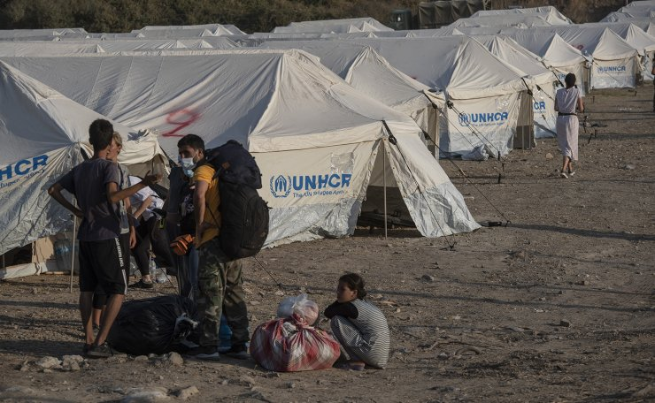 Migrants arrive at a temporary camp near Mytilene town, on the northeastern island of Lesbos, Greece, Saturday, Sept. 12, 2020. AP