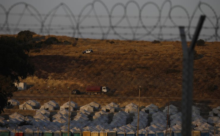 A police car patrols over a new temporary camp for refugees and migrants at Karatepe near Mytilene town, on the northeastern island of Lesbos, Greece, Sunday, Sept. 13, 2020. AP
