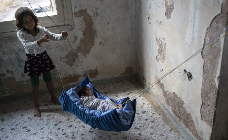 A two-month old baby from Afghanistan sleeps at an abandoned building near Mytilene town, on the northeastern island of Lesbos, Greece, Tuesday, Sept. 15, 2020.  Just over 6% of people have been rehoused, following a recent fire that destroyed Greece's biggest camp for refugees and migrants making 12,500 people homeless, in a new temporary facility under construction on the island of Lesbos. AP