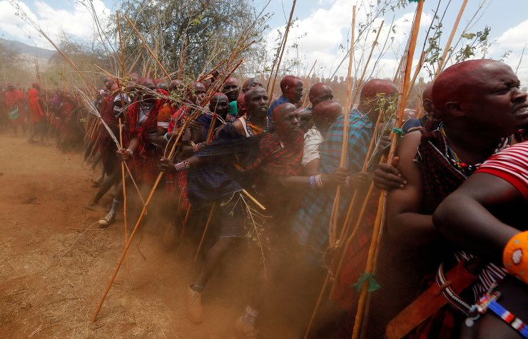 Maasai men of Matapato jostle to parade as they attend the Olng'esherr (meat-eating) passage ceremony to unite two age-sets; the older Ilpaamu and the younger Ilaitete into senior elder-hood as the final rite of passage, after the event was initially postponed due to the coronavirus disease (COVID-19) outbreak, in Maparasha hills of Kajiado, Kenya, September 23, 2020. REUTERS/Thomas Mukoya