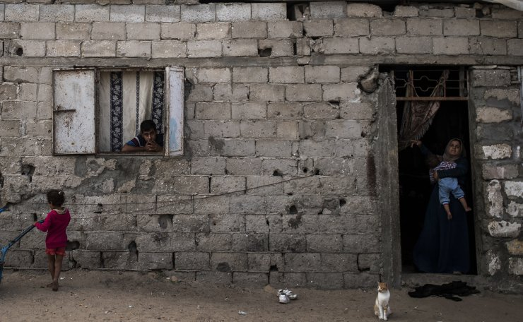 Palestinians are seen looking on from their house in a slum on the outskirts of Khan Younis Refugee Camp, in the southern Gaza Strip, Wednesday, Nov. 25, 2020. Israel's blockade of the Hamas-ruled Gaza Strip has cost the seaside territory as much as $16.7 billion in economic losses and caused its poverty and unemployment rates to skyrocket, a U.N. report said Wednesday, as it called on Israel to lift the 13-year closure. AP