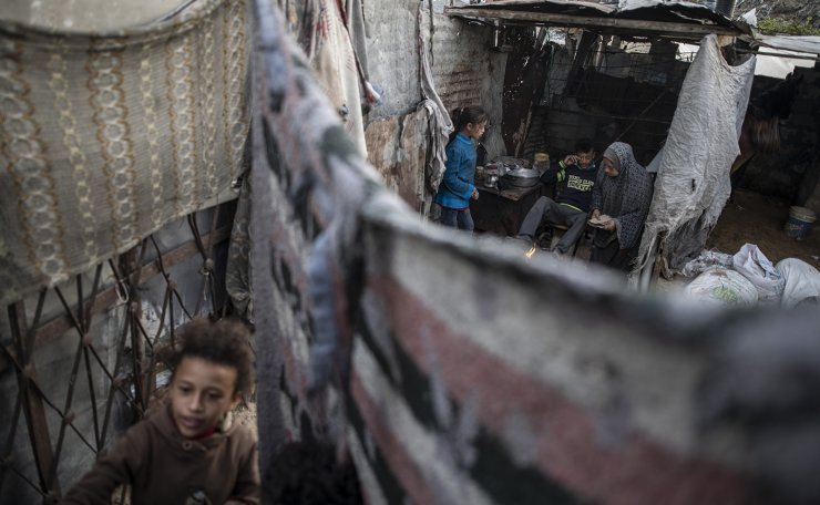 A Palestinian family prepares tea in their house in a slum on the outskirts of Khan Younis Refugee Camp, in the southern Gaza Strip, Wednesday, Nov. 25, 2020. AP
