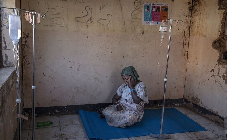 A Tigray woman who fled the conflict in Ethiopia's Tigray region, waits to get treatment at a clinic in Umm Rakouba refugee camp in Qadarif, eastern Sudan, Wednesday, Nov. 25, 2020. Misery continues for the refugees in Sudan, with little food, little medicine, little shelter, little funding and little or no contact with loved ones left behind in Tigray. AP