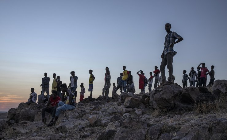 Tigray people who fled the conflict in Ethiopia's Tigray region, stand on a hill top over looking Umm Rakouba refugee camp in Qadarif, eastern Sudan, Thursday, Nov. 26, 2020. AP
