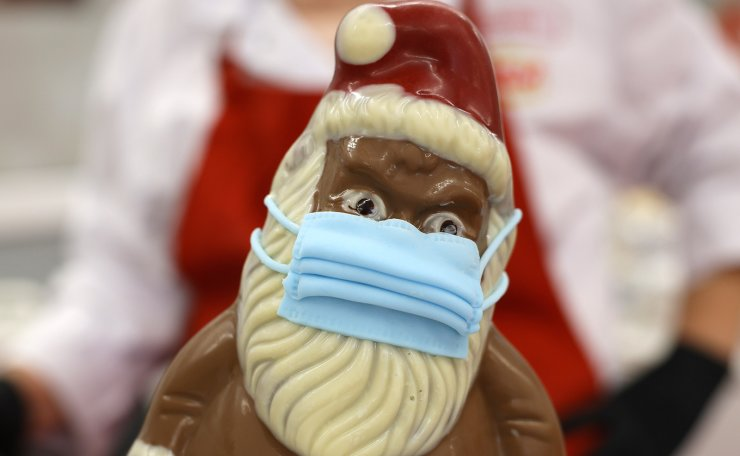 A Chocolate Santa with mask stand at the Wawi company in Pirmasens, Germany, 27 November 2020 (issued 30 November 2020). German confectionery company WAWI-Schokolade AG has started to manufacture chocolate Santa figures with face masks for Christmas 2020. EPA