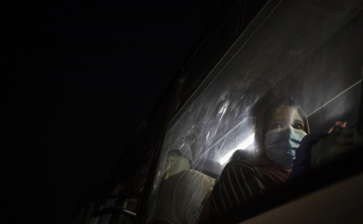 A Palestinian woman wearing a face mask to prevent the spread of the coronavirus waits in a bus in Gaza City to go to the Rafah border crossing into Egypt on Sept. 27, 2020. AP