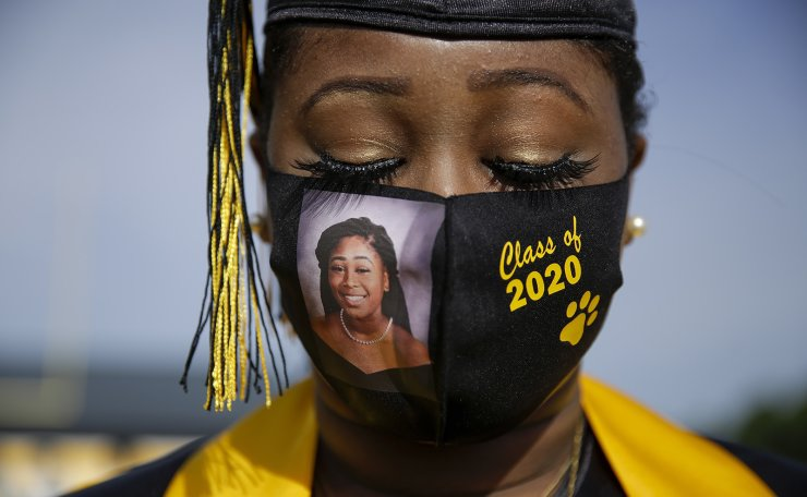 Yasmine Protho, 18, wears a photo of herself and 'Class of 2020' on her protective mask amid the COVID-19 virus outbreak as she graduates with only nine other classmates and limited family attending at Chattahoochee County High School in Cusseta, Ga., on May 15, 2020. AP