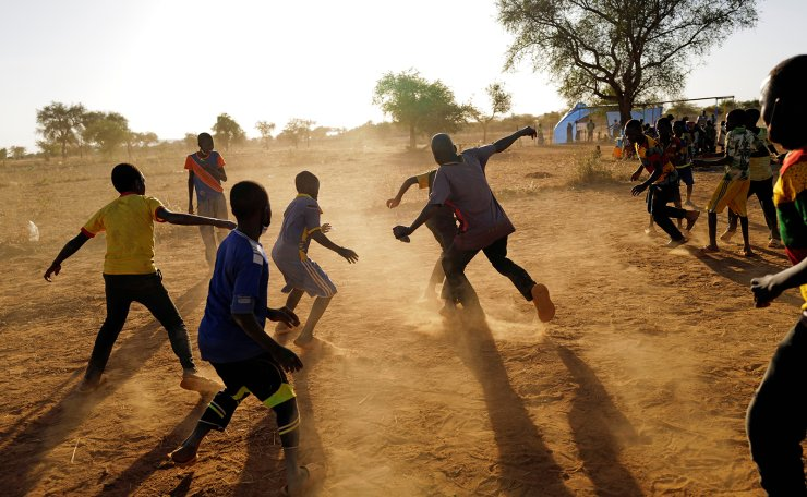 Children who fled from attacks of armed militants in the Sahel region play soccer at a camp for internally displaced people (IDPs) in Kaya, Burkina Faso November 23, 2020. Picture taken November 23, 2020. REUTERS