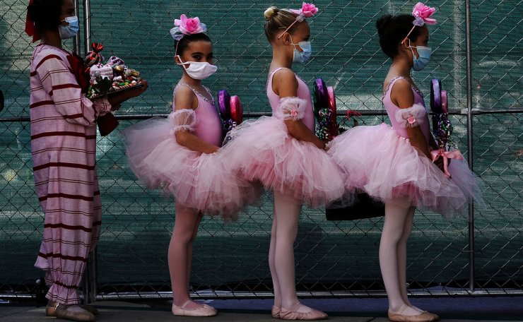 San Diego Ballet School students wear protective masks backstage during a performance of 'The Nutcracker', presented by the San Diego Ballet in a drive-in performance at a parking lot, as the coronavirus disease (COVID-19) outbreak continues in San Diego, California, U.S., December 5, 2020. REUTERS