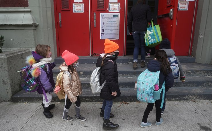 Children line up to attend class at PS 361 on the first day of a return to class during the coronavirus disease (COVID-19) pandemic in the Manhattan borough of New York City, New York, U.S., December 7, 2020. REUTERS