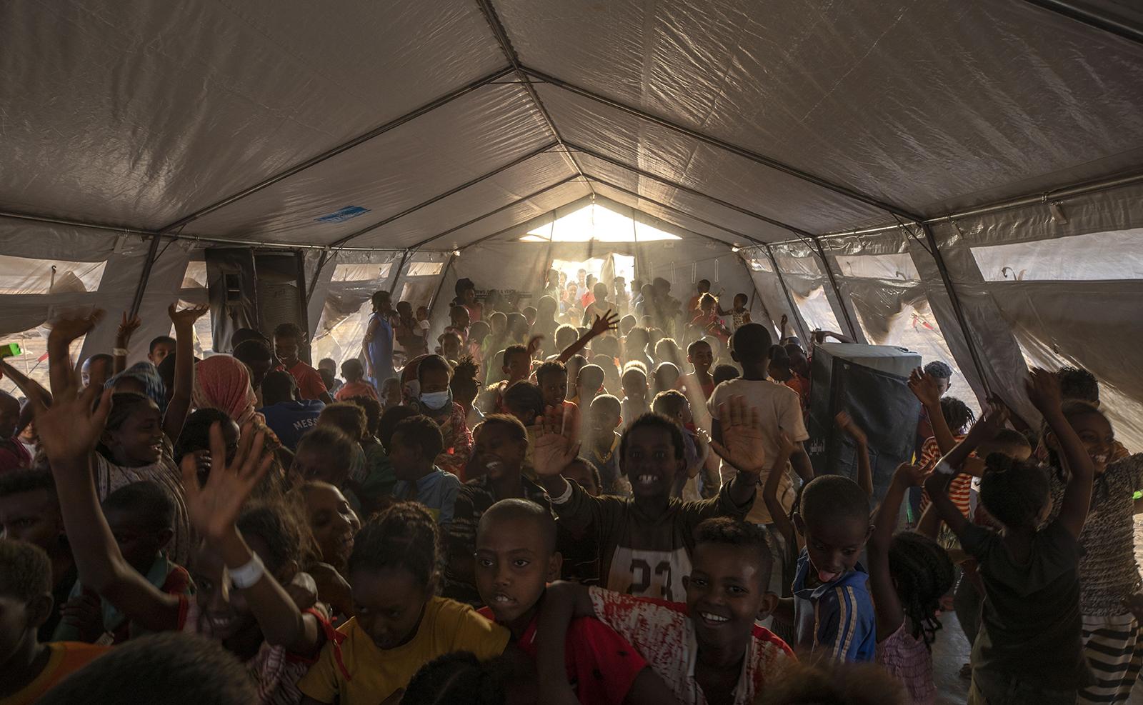 Tigray refugee children sing and dance inside a tent run by UNICEF for children's activities, in Umm Rakouba refugee camp in Qadarif, eastern Sudan, Thursday, Dec. 10, 2020. AP