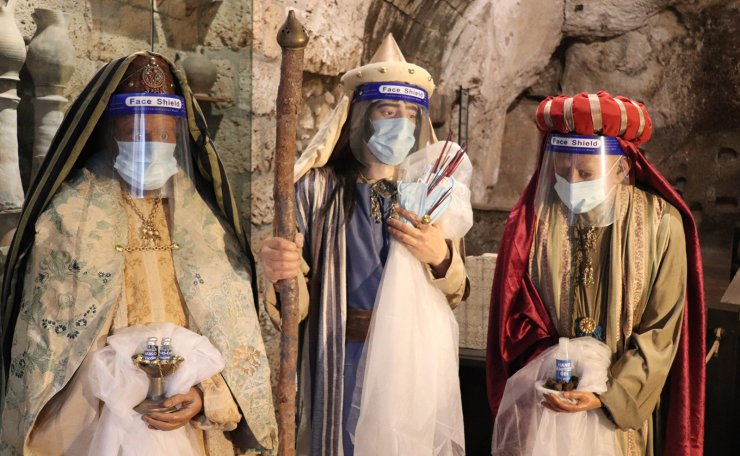 Scupltures of the Three Magi additionally bringing the Covid-19 vaccine and wearing face shields are on display in a evocative crib at Pozzo della Cava in Orvieto, Italy, 22 December 2020. EPA