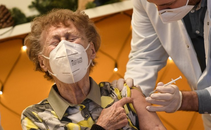 A resident of a nursing home reacts as she gets an injection of the COVID-19 vaccine in Cologne, Germany, Sunday, Dec. 27, 2020. AP